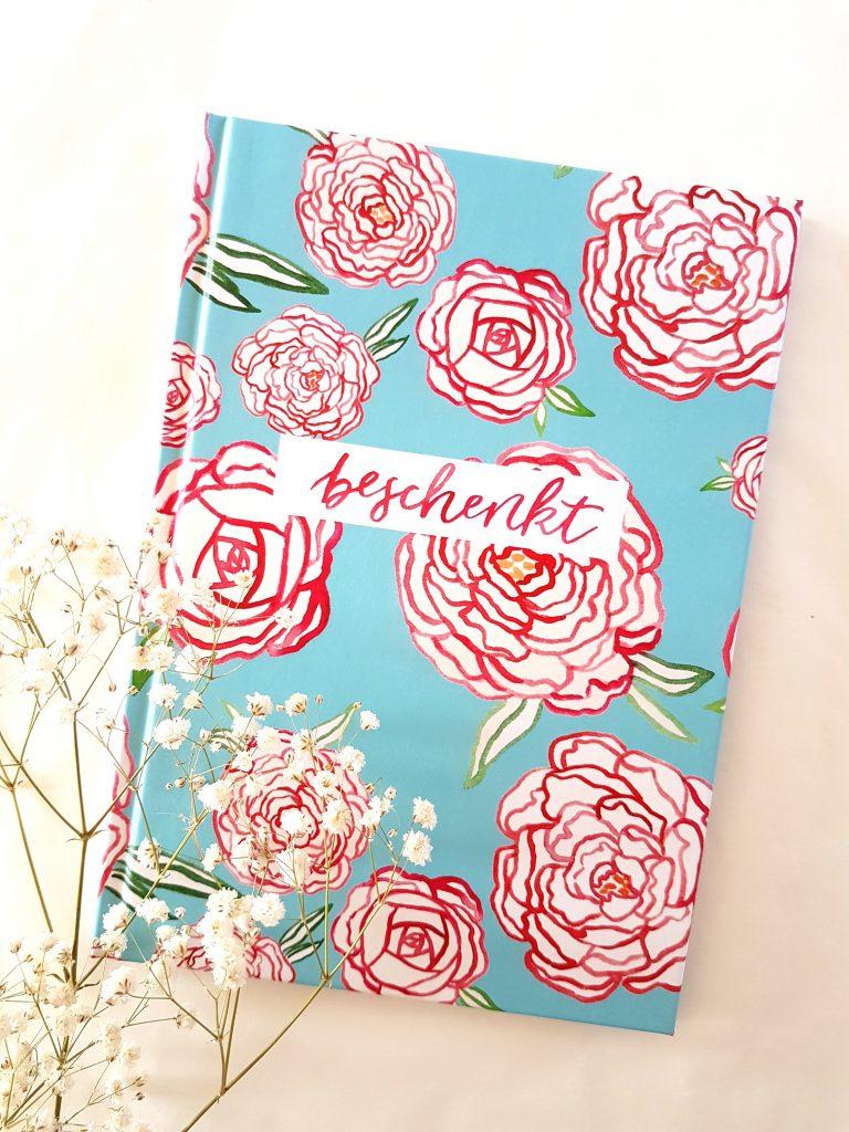 Notizbuch beschenkt